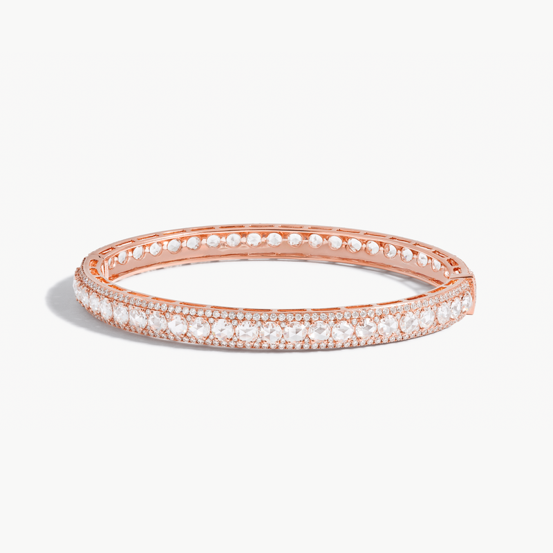 Linear Diamond Bangle. Rose Cut diamonds accented by smaller brilliant cut diamonds.