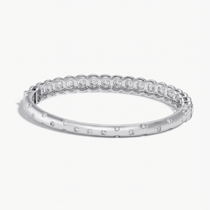 Back Side of Oval Shaped Hinged Diamond Half-Bangle. Round rose-cut diamonds accented by round brilliant-cut diamonds on front-side, with pave diamonds spread out on the back-side. 18k White Gold.