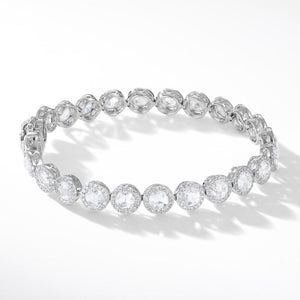 Diamond Tennis Bracelet. Round rose-cut diamonds accented by round brilliant-cut diamonds. 18k White Gold.