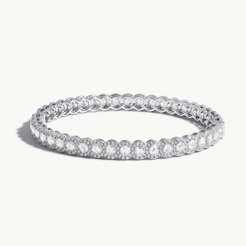 Scallop Diamond Bangle Bracelet. Round rose-cut diamonds accented by round brilliant cut diamonds. 18k White Gold.