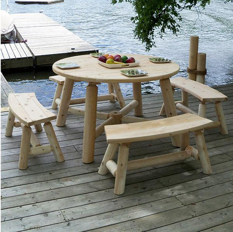 outdoor round table on a deck by the lake