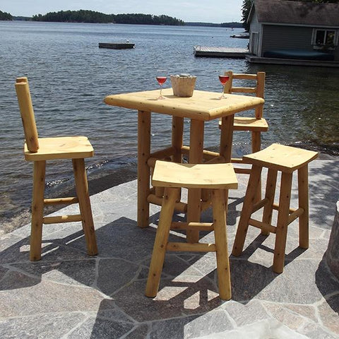 square high top pub table with barstools on patio stone next to the lake.