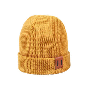 Matching adult and child knitted beanie hat