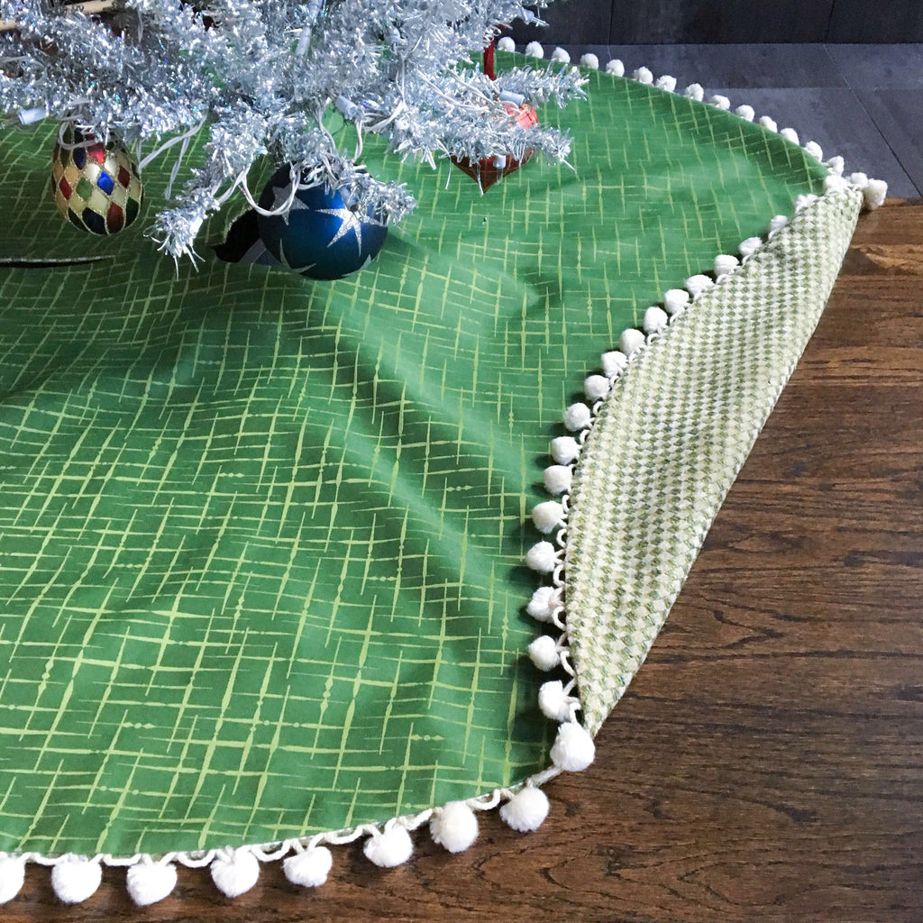 "48"" Reversible Green and White Contemporary Christmas Tree Skirt with Pom Pom Fringe 