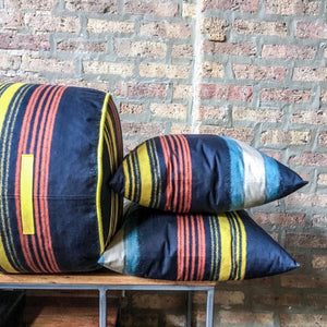 "Navy blue, red and yellow striped pouf ottoman | 10"" high x 17"" wide 