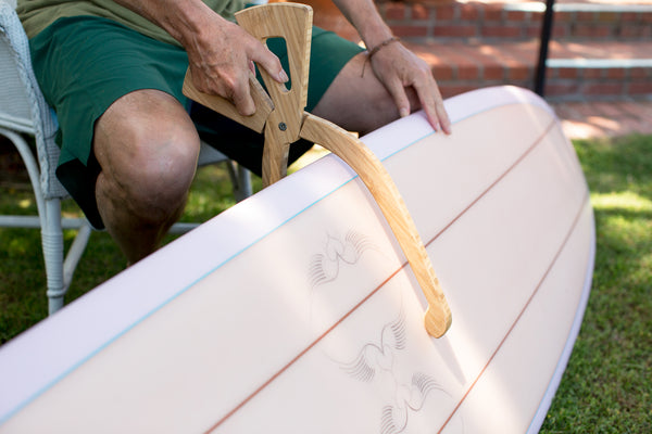 Rich Pavel measuring a hand shaped surfboard
