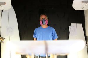 Michael Miller surfboard shaper standing in his shaping room