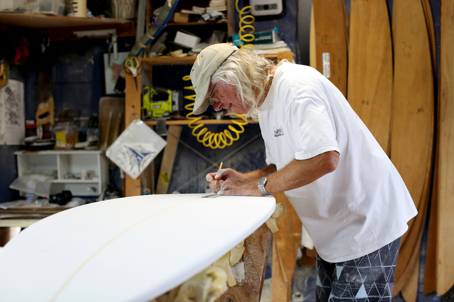 Gary Hanel working in his surfboard shaping room making surfboards
