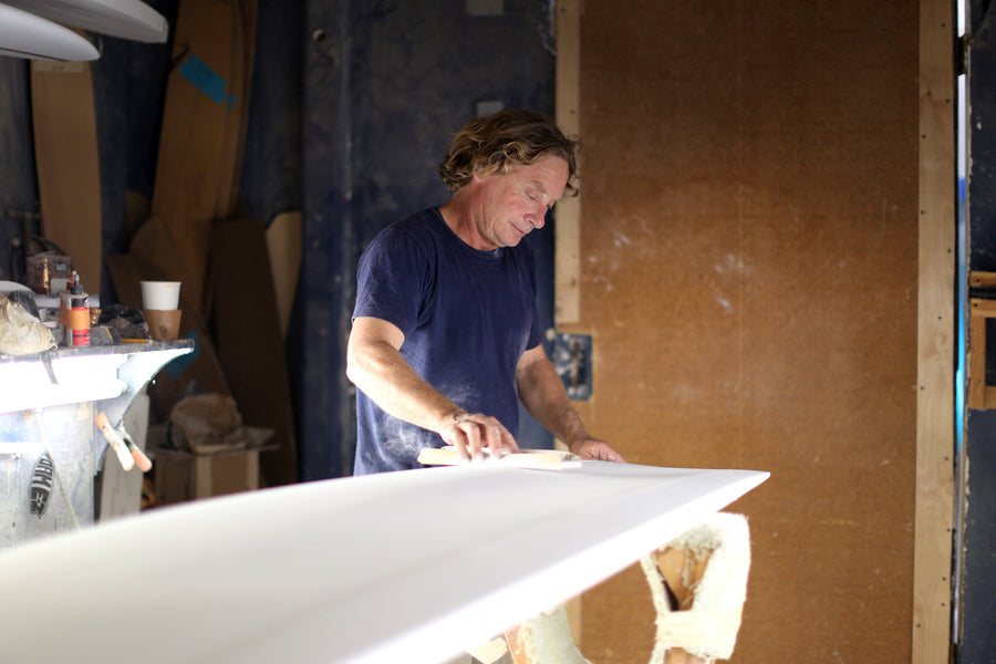 Jon Wegener shaping a surfboard in his shaping room