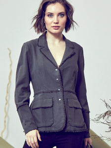 go coat of many details - Machine washable semi-fit silk and cotton twill jacket, with deep V-neck collar with raw edge, full snap front closure and full length long sleeves with an elongated cuff. Large pack pockets and a back belt detail, this item is perfect for fall dressing.  Model front shot, black top.