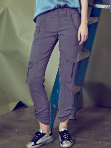ICONIC go army pant - Machine washable silk and spandex mix cargo styled army pants with banded waist that sits just below natural waist with 9.5 inch rise based on a size 4. It has a zip fly with metal button closure and multiple pocket detailing and burnished hardware trim that sits below natural waist. It has a straight leg fit and convertible leg length with snap tabs.