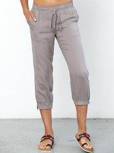 ICONIC go parachute capri pant - Machine washable pull on silk capri jogger with full back elastic waist with drawstring detail. It features metal hardware detail with front patch pockets and an elasticized zip-slit hem with snaps.
