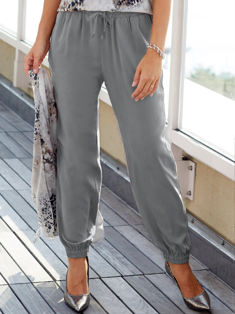 Go golden parachute pants - Machine washable easy fit pull on silk parachute pants with full elastic waist with drawstring detail that uses a metallic thread. The ribbon detail goes down the side of legs and has elasticized leg openings and slit pockets.
