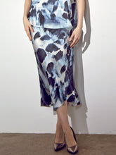 Load image into Gallery viewer, ICONIC go luxe bias skirt print 2- Machine washable silk charmeuse midi length skirt that has a bias cut and asymmetrical seamed hem and a velvet elastic waistband. This item has an abstract brush stroke exclusive print design.