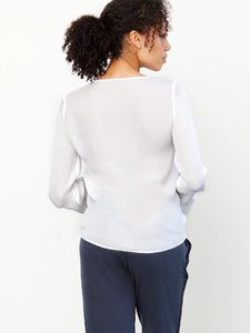 go draw it up top - Machine washable pullover silk drawstring top has a vee neck with front drawstring detail and a double-layer ruffle and elasticized cuff.
