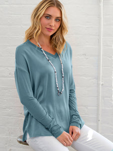 ICONIC go tee vee top - Machine washable pull over silk charmeuse tee with wide vee neckline, rib knit neckline trim and finished with our signature raw edge hems. This is our best-selling ICONIC style.