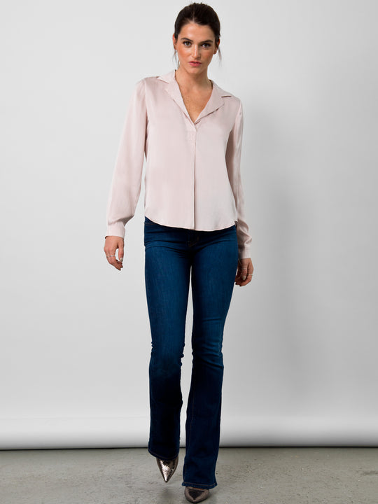 Go luxe anywhere top - Machine washable pull over silk charmeuse top with stylized notch collar neckline, box pleat front detail and long sleeves with barrel button through cuffs. It features back yoke inverted pleat and a self locker loop back detail with high/low shirttail hem.