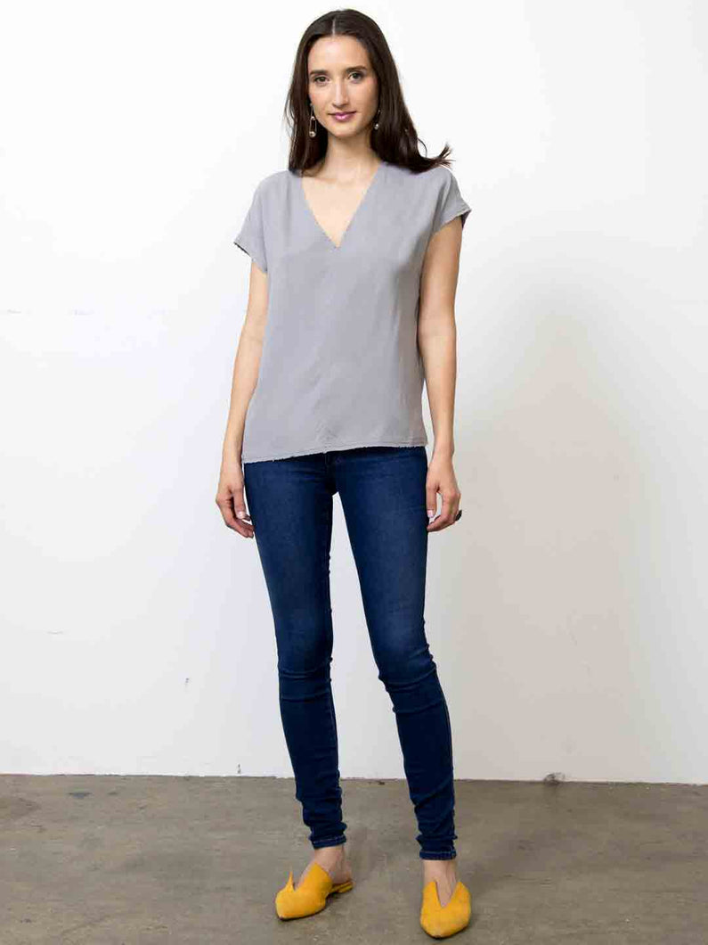 Go raw revisited tee - Machine washable easy boxy fit pull over silk dress with raw edges, deep vee neck and a center front seam detail. Featuring extended sleeves with curved high low hem.