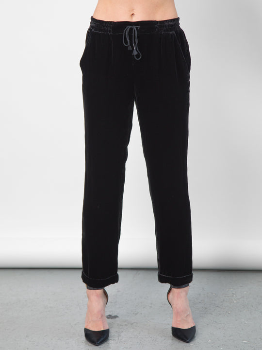 Go velvet everyday pants - Hand wash or dry cleanable 82% rayon and 18% silk velvet pull on mixed pants with silk drawstring cord at waist with self tassel. It has an elastic waistband that sits just below the natural waist with a 9 inch rise. It has front slit pockets with a tapered leg and cuffed hems, its at a 25 inch inseam based on a size small.