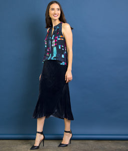 Go velvet underground skirt - Machine washable 82% rayon and 18% silk washed velvet blend skirt with bias cut and an asymmetrical seamed hem. This item also has a velvet elastic waistband at a midi length.