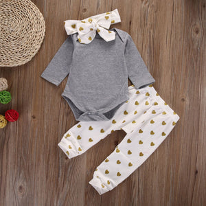 Adorable 3 piece set! Includes Onsie, heart print pants with matching headband