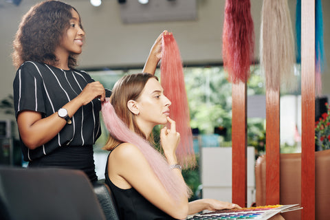 woman choosing hair extensions