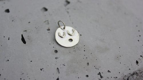 Singing face in sustainable sterling silver