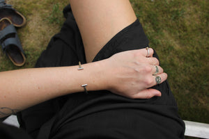 Handmade sustainable jewellery. Here shown minimal cuff bracelet and rings