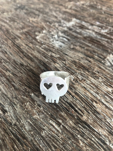 minimal designer skull ring with heart eyes made in recycled sterling silver