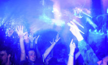 Load image into Gallery viewer, Ravers on the main blue dance floor at The Hacienda Manchester