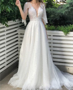 White Deep V Neck Backless Wedding Dresses Pearl Bridal Gown