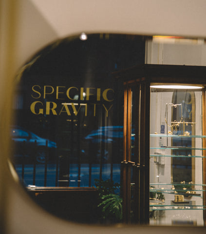 Specific Gravity reflected in the mirror with showcase and street view