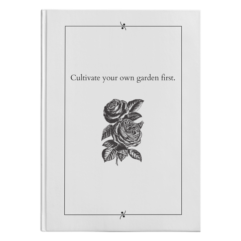 white journal with black and white flower beneath text reading cultivate your own garden first