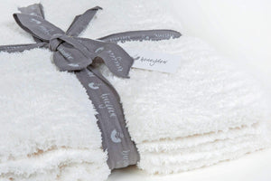 marshmallow ivory throw blanket wrapped with a ribbon FunkChez