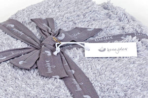 marshmallow heather grey throw blanket wrapped with a ribbon FunkChez