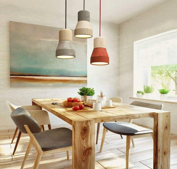 3 Amara country style pendant lights set over a dining table