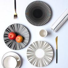 Load image into Gallery viewer, 2 PLATES FROM THE DEJAVU DINNERWARE COLLECTION PLACED ON A TABLE SETTING