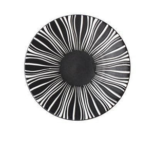 BLACK WITH WHITE LINES PRINTED ON A DEJAVU DINNER PLATE