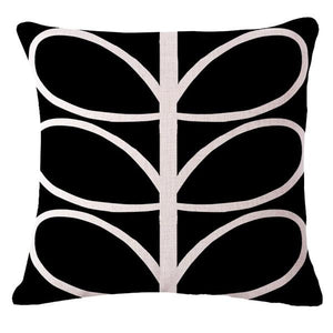 Funky black cushion cover with white abstract leaves
