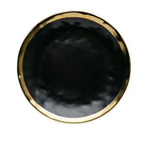 karma dinnerware plate in black with gold lining