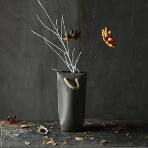 luna dark grey planter pot with artificial stems and yellow flower