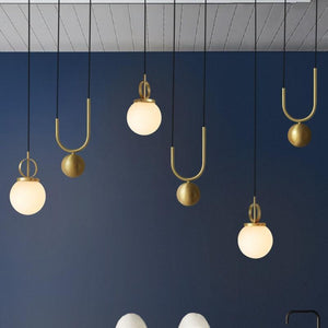 3 Madorne pendant lights hanging from the ceiling - FunkChez