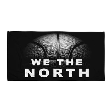 We the north text and basket ball printed on a beach towel FunkChez