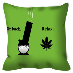 Sit back relax printed on a green outdoor throw cover