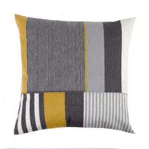 cushion cover with grey, mustard yellow, black and white in geometrical stripes