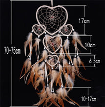 Load image into Gallery viewer, brown feathers on a dreamcatcher with white heart shaped rings and size specifications