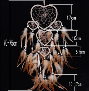brown feathers on a dreamcatcher with white heart shaped rings and size specifications