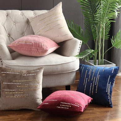5 luxury cushions in different colours placed on a couch