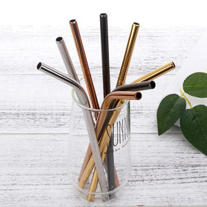 8 assorted stainless steel straws in different colours in a glass