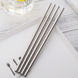 4 stainless steel straws placed on a plate